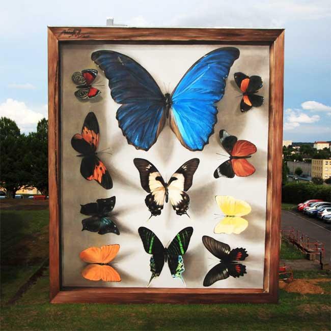 papillons murs street art mantra, L'Artiste Mantra Peint des Papillons Géants sur les Murs des Villes
