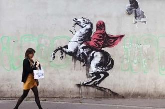 street art paris migrants banksy