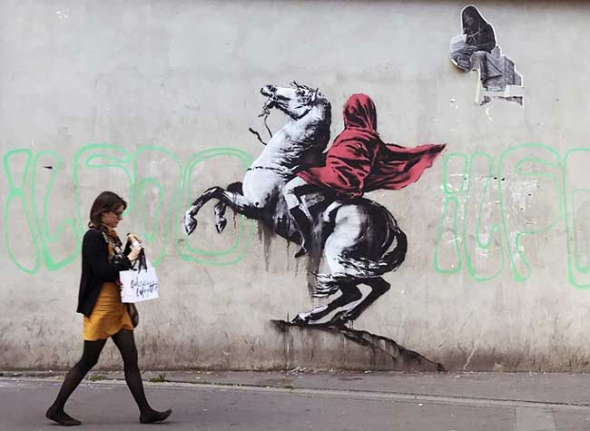 street art paris migrants banksy