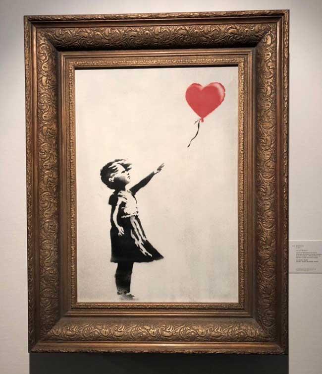 banksy fille ballons auto destruction tableau sothebys 2 - Une Peinture de Banksy s'Autodetruit durant une Vente aux Enchères (video)
