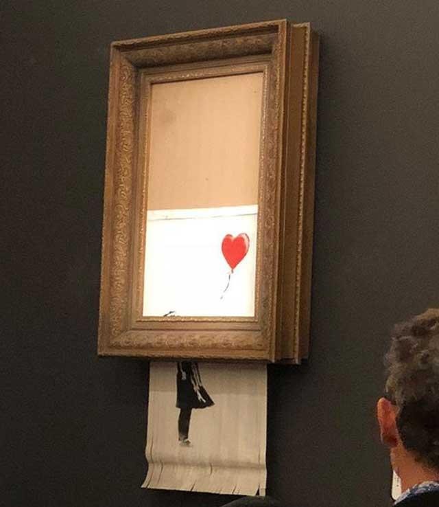 banksy fille ballons auto destruction tableau sothebys 3 - Une Peinture de Banksy s'Autodetruit durant une Vente aux Enchères (video)